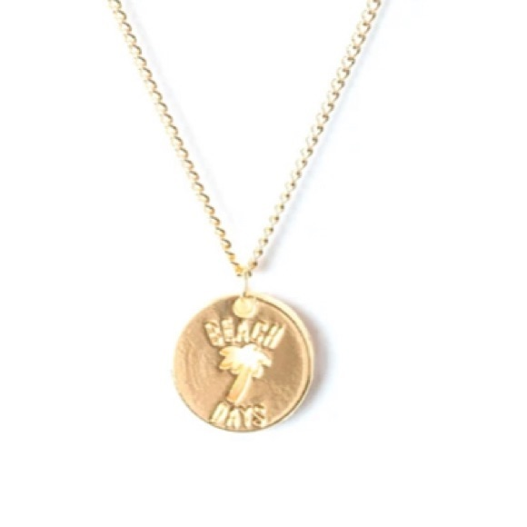 K10 Gold necklace with palm tree cutout